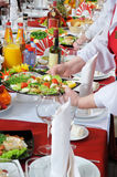 On a table there is a lot of food. Stock Images