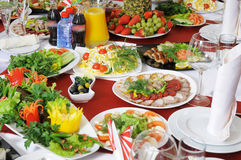 On a table there is a lot of food. royalty free stock image