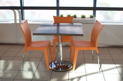 Table and three chairs in a cafe Royalty Free Stock Photo