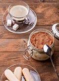 Table with tiramisu, pastry, espresso Stock Photos