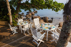 A table to lunch in beach of Saco do Mamangua royalty free stock image