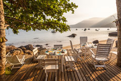 A table to lunch in beach of Saco do Mamangua stock photography