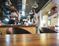 Table top with bar counter Blurred restaurant background Royalty Free Stock Photography