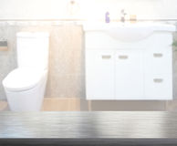 Table Top And Blur Bathroom Of Background. Table Top And Blur Bathroom Of The Background Royalty Free Stock Photos