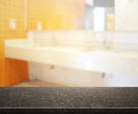 Table Top And Blur Bathroom Of Background. Table Top And Blur Bathroom Of The Background Stock Photo