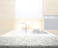 Table Top And Blur Kitchen Room Of Background. Table Top And Blur Kitchen Room Of The Background Royalty Free Stock Photo