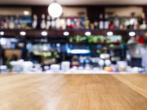 Table top with Blurred Bar restaurant cafe interior background Royalty Free Stock Images