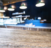 Table top with Blurred Cafe Kitchen interior background Stock Image