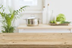 Table top with blurred kitchen interior as background.  Royalty Free Stock Photos