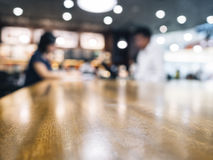 Table top with blurred people in cafe background Royalty Free Stock Image