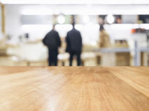 Table Top with Blurred people in shop interior background Stock Photos