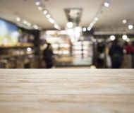 Table top with Blurred Retail shop Interior background Stock Image