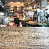Table top with Blurred Retail shop store Background Royalty Free Stock Image