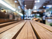 Table top with Blurred Retail shop store Background. Table top wooden counter with Blurred Retail shop store Background Stock Photography