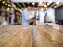 Table Top counter Bar with Blurred Barista background. In restaurant cafe stock images