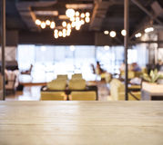 Table top counter Bar with Blurred Cafe Restaurant background Royalty Free Stock Image