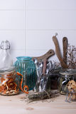 Table top counter bar with kitchen ware, thyme, orange peel, cookies, grocery, white background. Stock Image