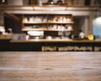 Table top counter Blur Bar shelf people in Cafe restaurant Royalty Free Stock Image