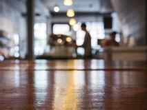 Table top Counter with Blur Barista Brewing coffee Cafe Restaurant Interior royalty free stock photos