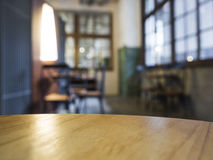 Table top counter with blurred Bar Cafe Restaurant Interior background. Wooden Table top counter with blurred Bar Cafe Restaurant Interior background stock photo