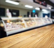 Table Top counter with Blurred Fresh food Display in Sup Royalty Free Stock Photography