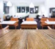 Table top Counter with Blurred table with seats Restaurant Shop Stock Photo