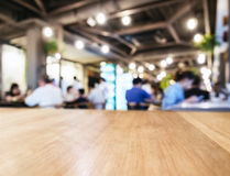 Table top counter in Coffee shop cafe Blurred people background Royalty Free Stock Images