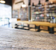 Table top counter and seats with blurred bar background Royalty Free Stock Photo