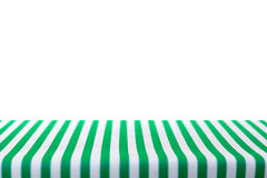 Table top covered with green and white stripped tablecloth Stock Images