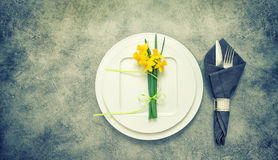 Table top with cutlery, napkin, spring flowers Royalty Free Stock Image