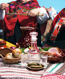 Table top full of foods and women in traditional clothes Royalty Free Stock Photo