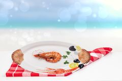 Table top on seafood background. A Fresh grilled big prawn tiger or shrimps on a white table in front of abstract blurred tropical stock photos