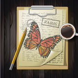 Table top with sketching paper and butterfly Stock Image