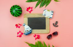 Table top view accessory plan to travel beach in summer holiday background concept.Flat lay  palm leaf with many essential items. Flower & palm leaf on pink royalty free stock photo