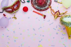 Table top view aerial image of beautiful colorful carnival season or photo booth prop Mardi Gras background. Flat lay mask with decorations and confetti & stock photo