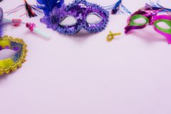 Table top view aerial image of beautiful colorful carnival season or photo booth prop Mardi Gras background. Flat lay colorful mask with decorations and royalty free stock image
