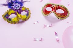 Table top view aerial image of beautiful colorful carnival season or photo booth prop Mardi Gras background.Flat lay colorful mask. With decorations and royalty free stock photos