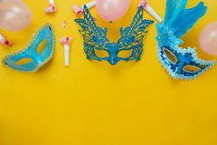 Table top view aerial image of beautiful colorful carnival season or photo booth prop Mardi Gras background. Flat lay object blue mask with decorations and royalty free stock photography