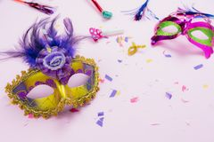 Table top view aerial image of beautiful colorful carnival season or photo booth prop Mardi Gras background. Flat lay object gold mask with decorations and royalty free stock image