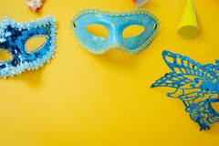 Table top view aerial image of beautiful colorful carnival season or photo booth prop Mardi Gras background. Flat lay objects colorful blue mask with royalty free stock photography