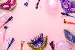 Table top view aerial image of beautiful colorful carnival season or photo booth prop Mardi Gras background. Flat lay objects colorful mask with confetti and royalty free stock photo