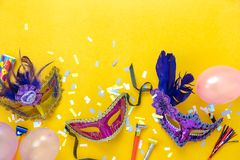 Table top view aerial image of beautiful colorful carnival season or photo booth prop Mardi Gras background. Flat lay variety mask with decorations and confetti royalty free stock photo