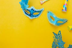 Table top view aerial image of beautiful colorful carnival season or photo booth prop Mardi Gras background. Flat lay object blue mask with decorations on royalty free stock images
