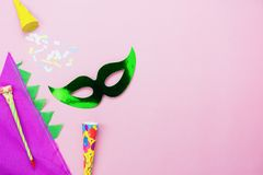 Table top view aerial image of beautiful colorful decorations Mardi Gras or carnival festival background.Flat lay accessory object. The mask & hat with decor stock photo