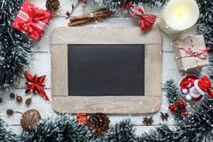 Table top view aerial image of Decoration & Ornament Merry Christmas with Happy new year. Concept background.Blackboard for free space creative design font.An Stock Photo