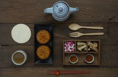 Table top view aerial image of decorations Chinese Moon Festival background concept. Flat lay essential meal set for coffee break of sweet cake & tea with snack stock photos