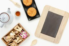 Table top view aerial image of decorations Chinese Moon Festival background concept. Flat lay snack break the sweet cake & tea with backboard for mock up on stock images