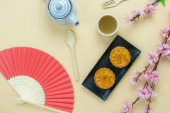 Table top view aerial image of decorations Chinese Moon Festival or lunar new year. Background concept.Flat lay essential meal set of green tea with sweet moon stock photo