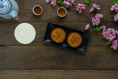 Table top view aerial image of decorations Chinese Moon Festival or lunar new year background. Concept.Flat lay essential meal set for coffee break of sweet stock photography