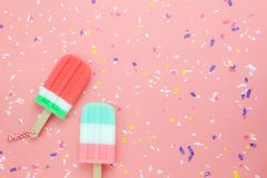 Table top view aerial image of food for summer holiday background concept. Flat lay ice cream pop stick on modern rustic pink paper wallpaper.Copy space for Royalty Free Stock Photography